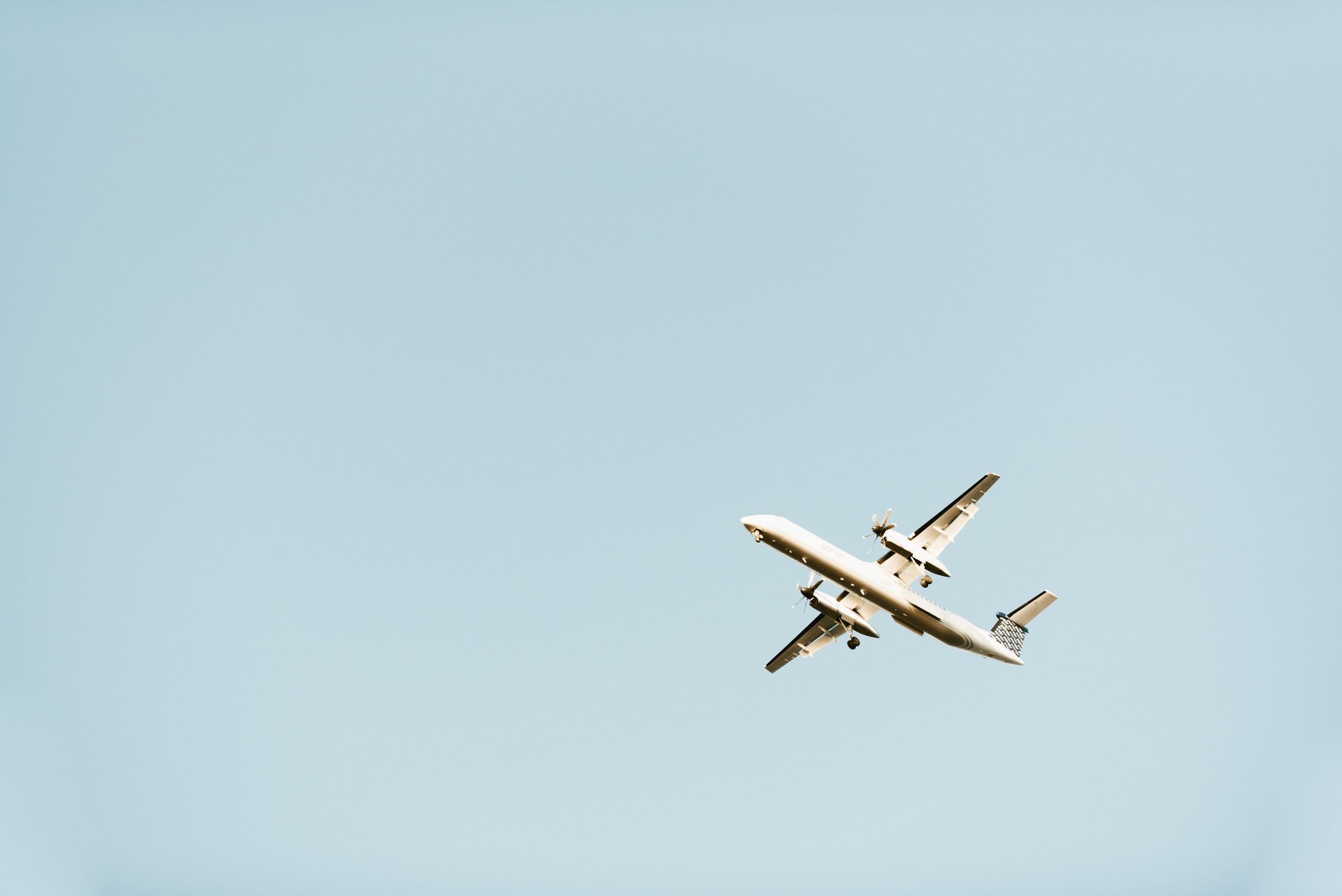 Plane flying over Cherry Beach in Toronto
