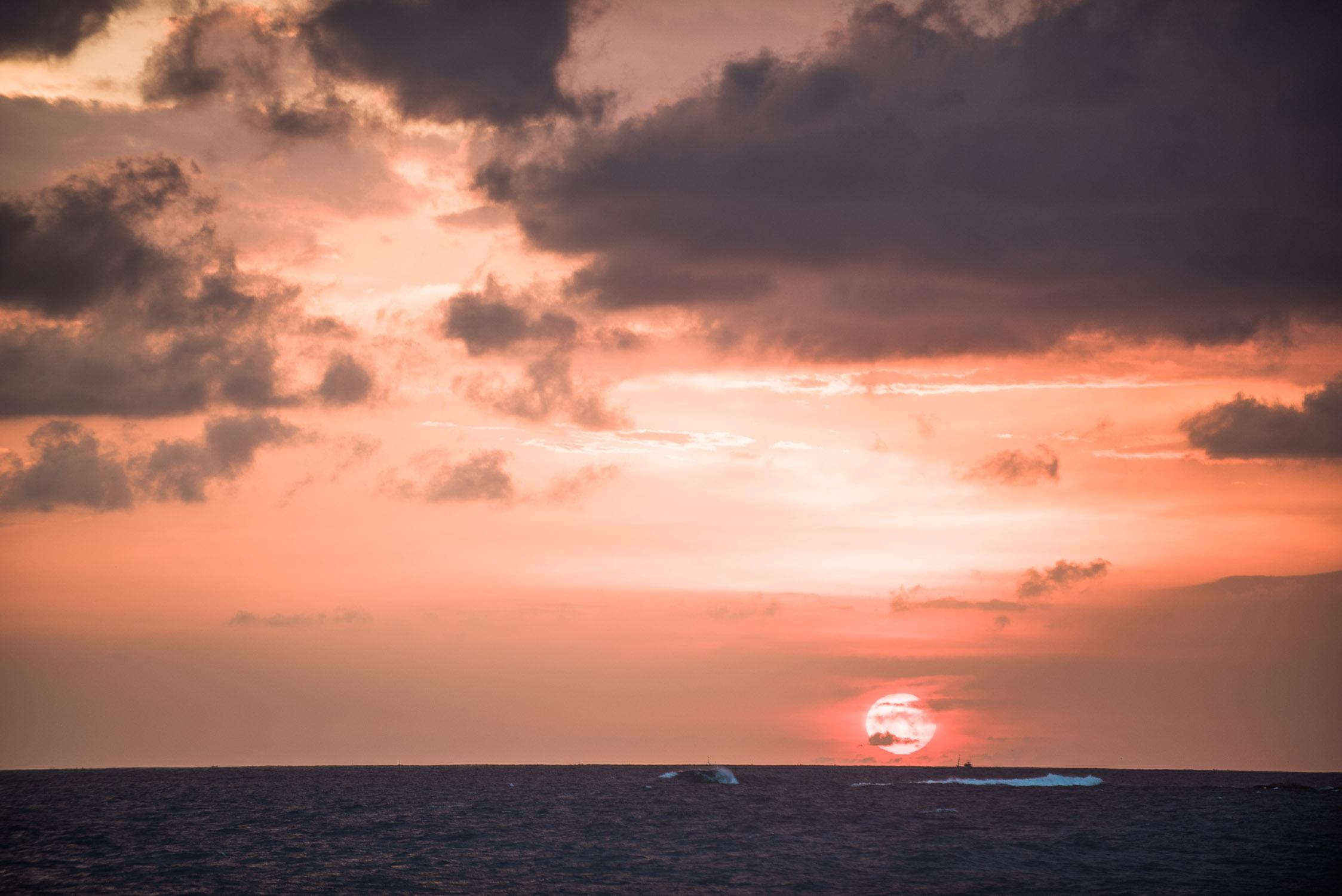 Sunset just above horizon in Sri Lanka on Mirissa Beach