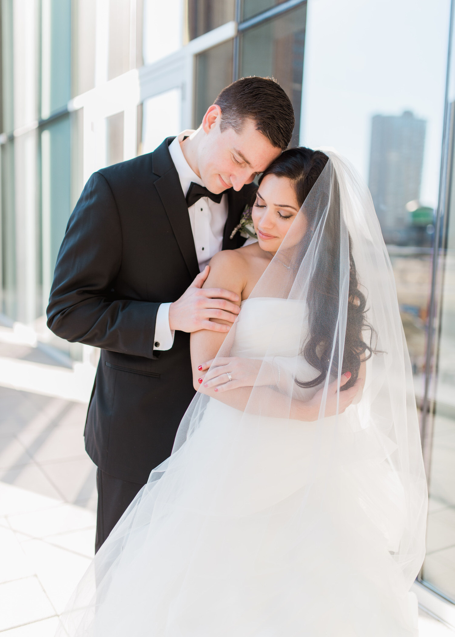 Bride and groom share a moment during elopement at Toronto Delta hotel