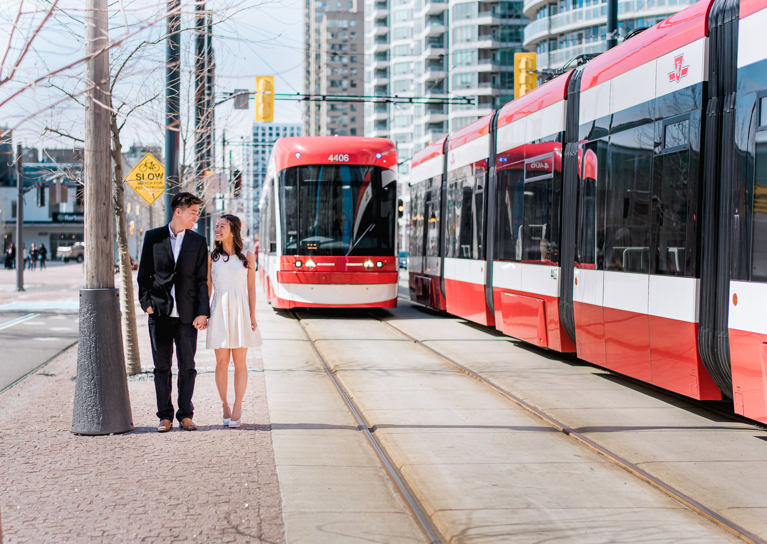 Couple waiting for the streetcar TTC to pass along Harbourfront in Toronto