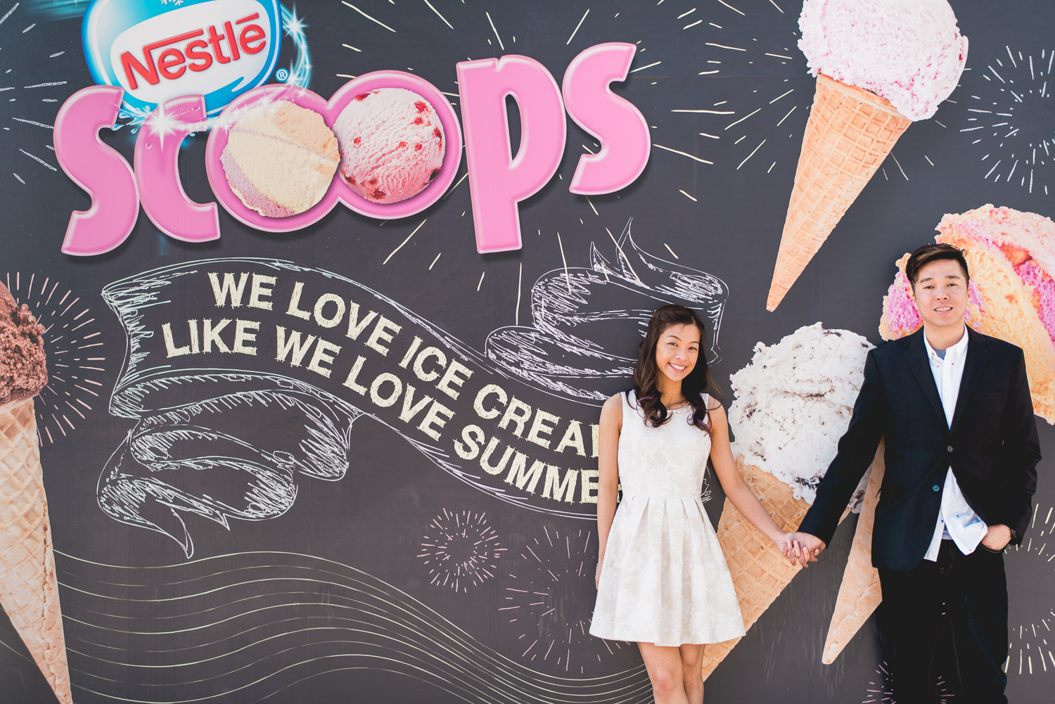 Couple standing in front of Nestle Scoops Poster