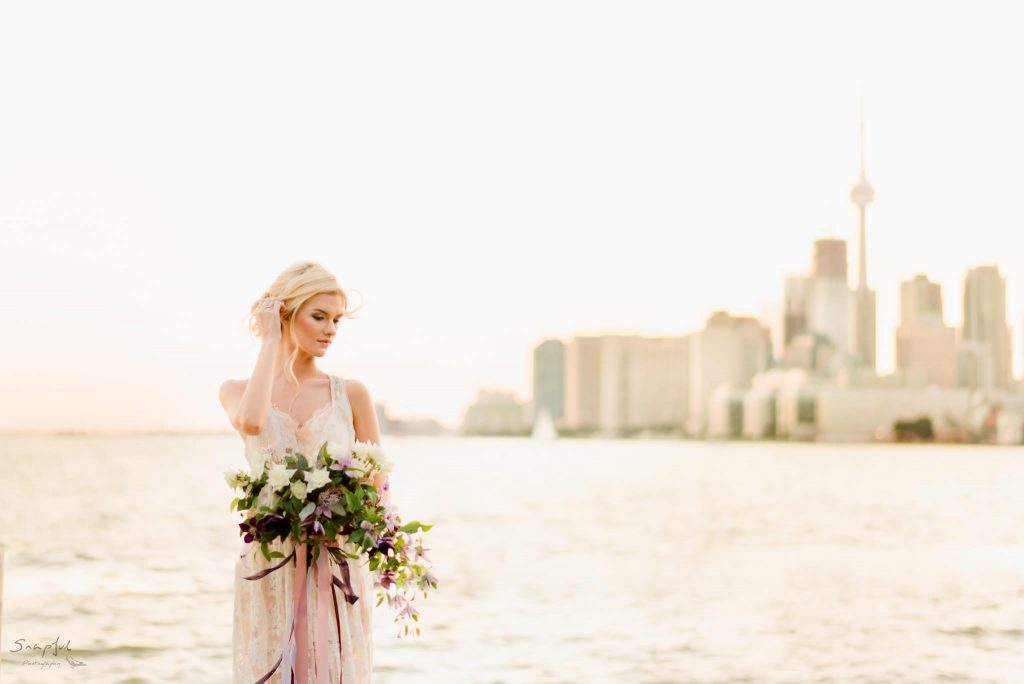 Portrait of bride in front of Toronto skyline