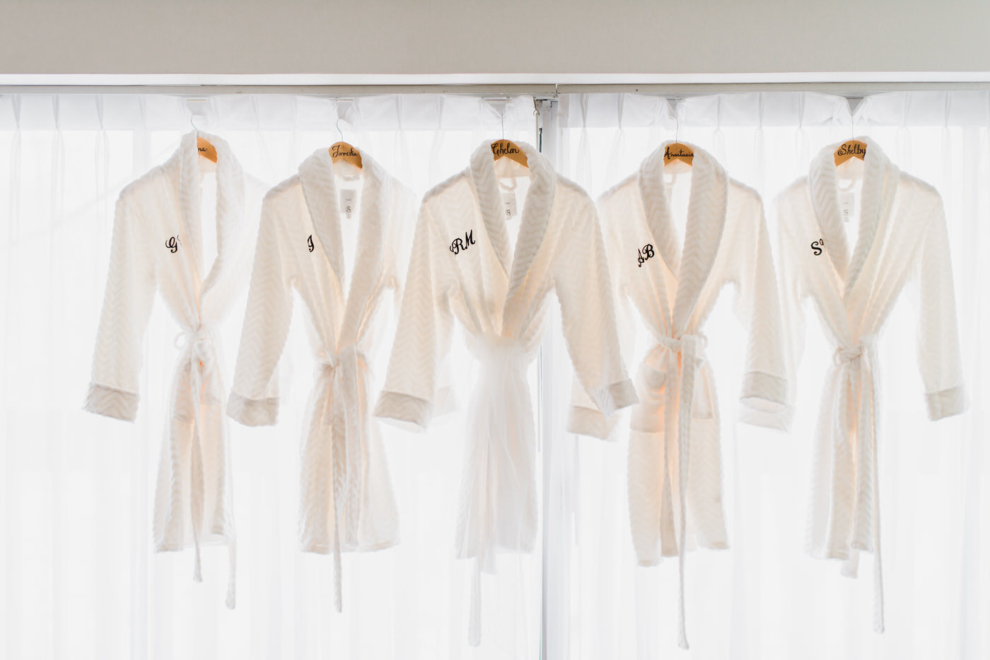 bridesmaids dresses hanging on frame