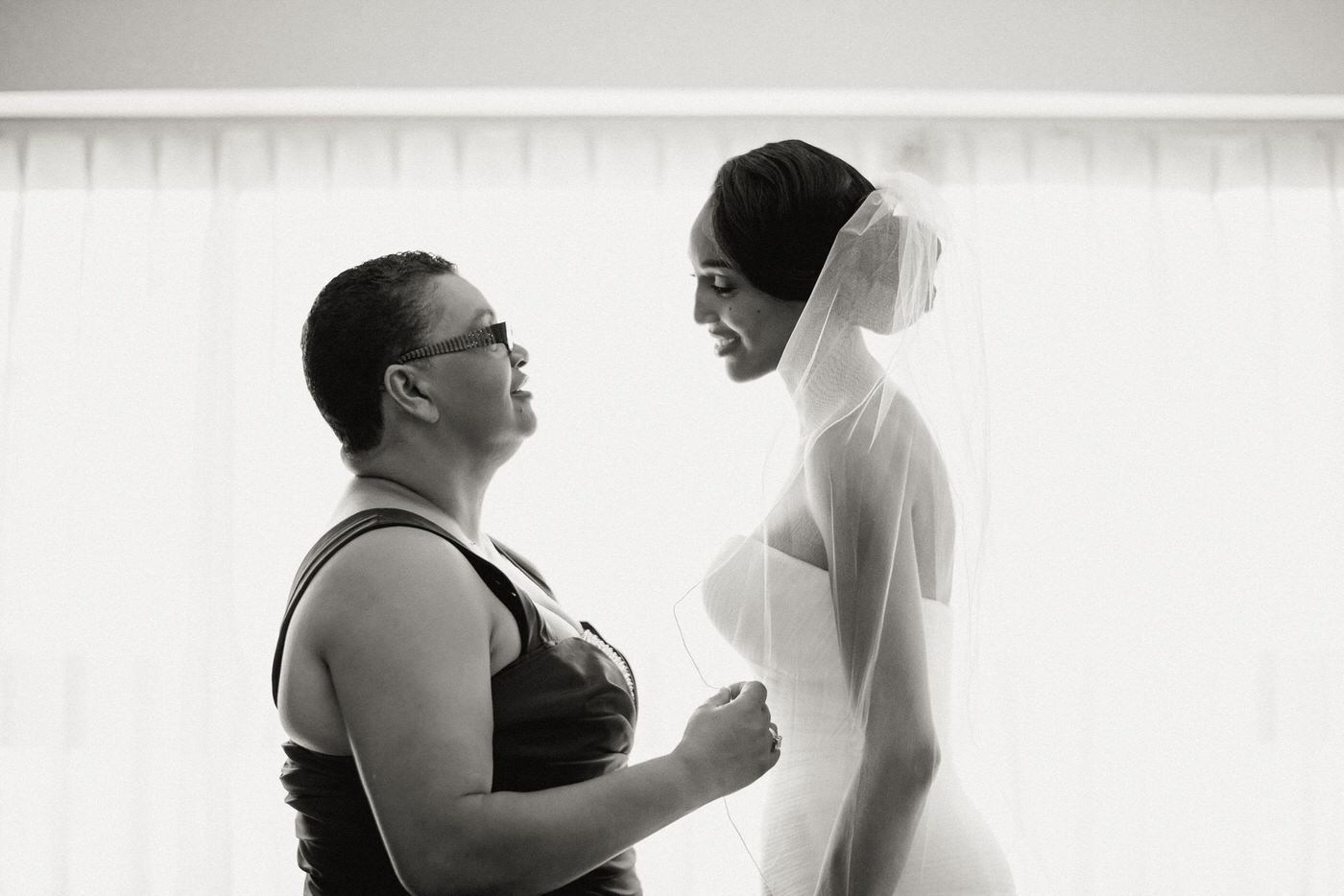 Bride and mom sharing a moment in her wedding dress