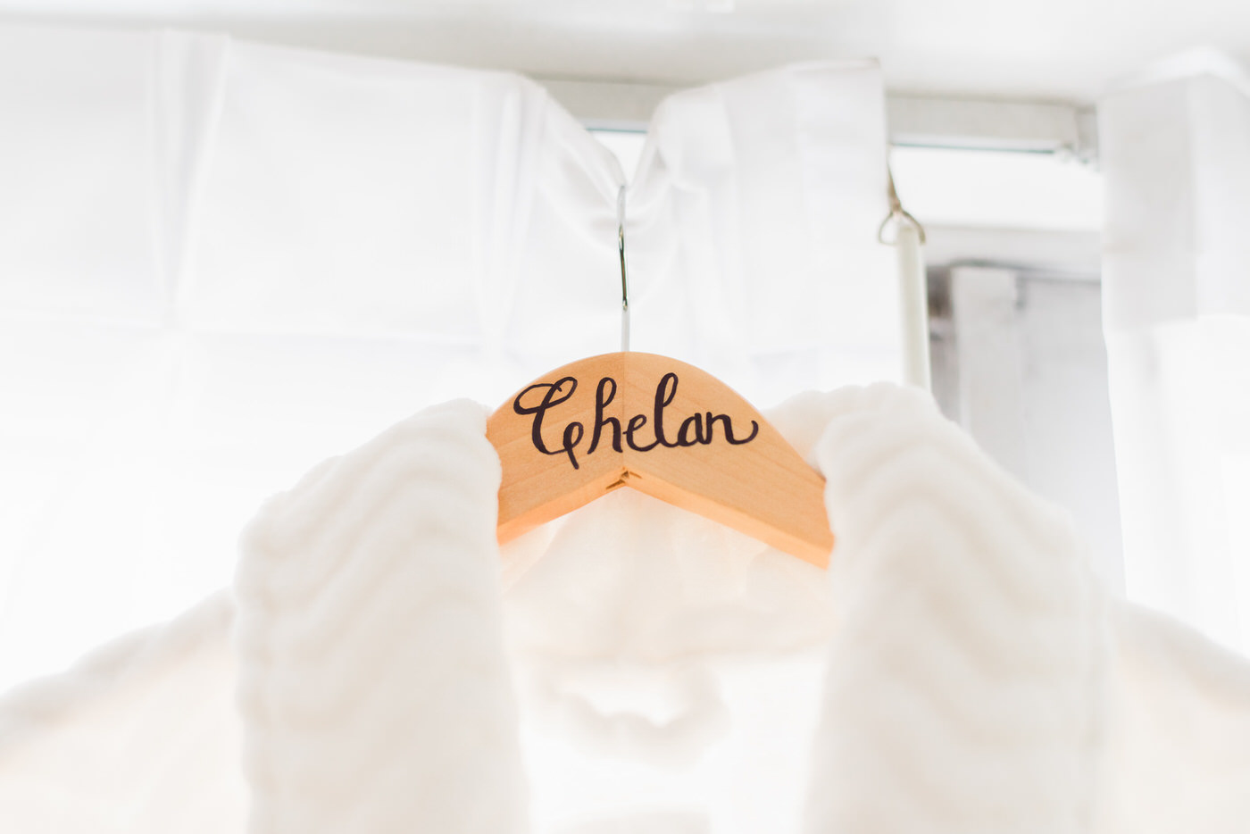 Photo of bride's personalized robe hanger