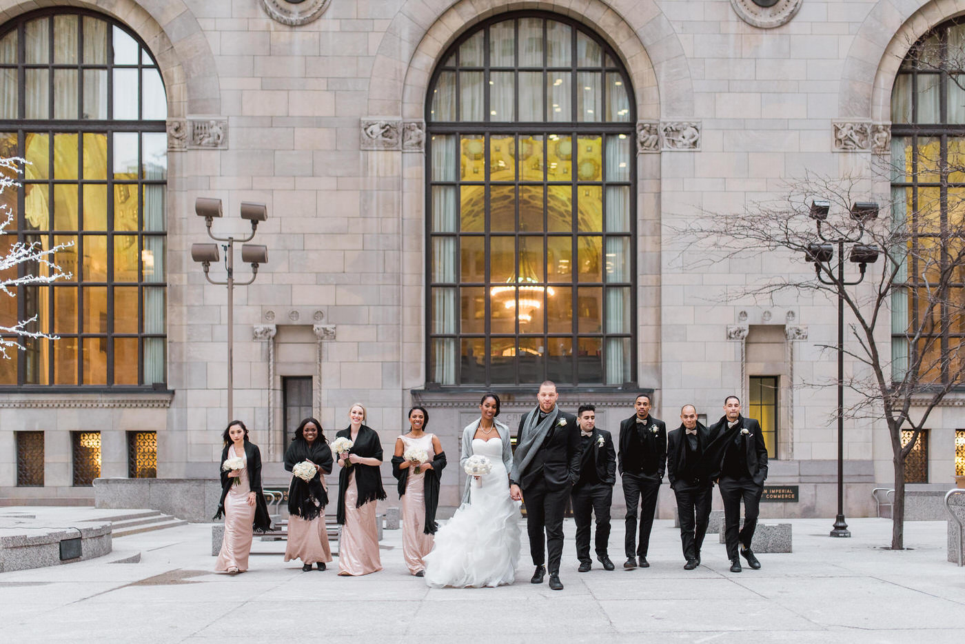 Wedding party walking downtown in Toronto on New Year's Eve wedding at One King West