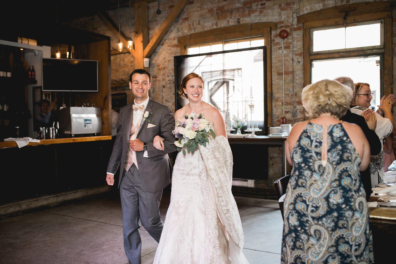 Bride and groom entering Archeo