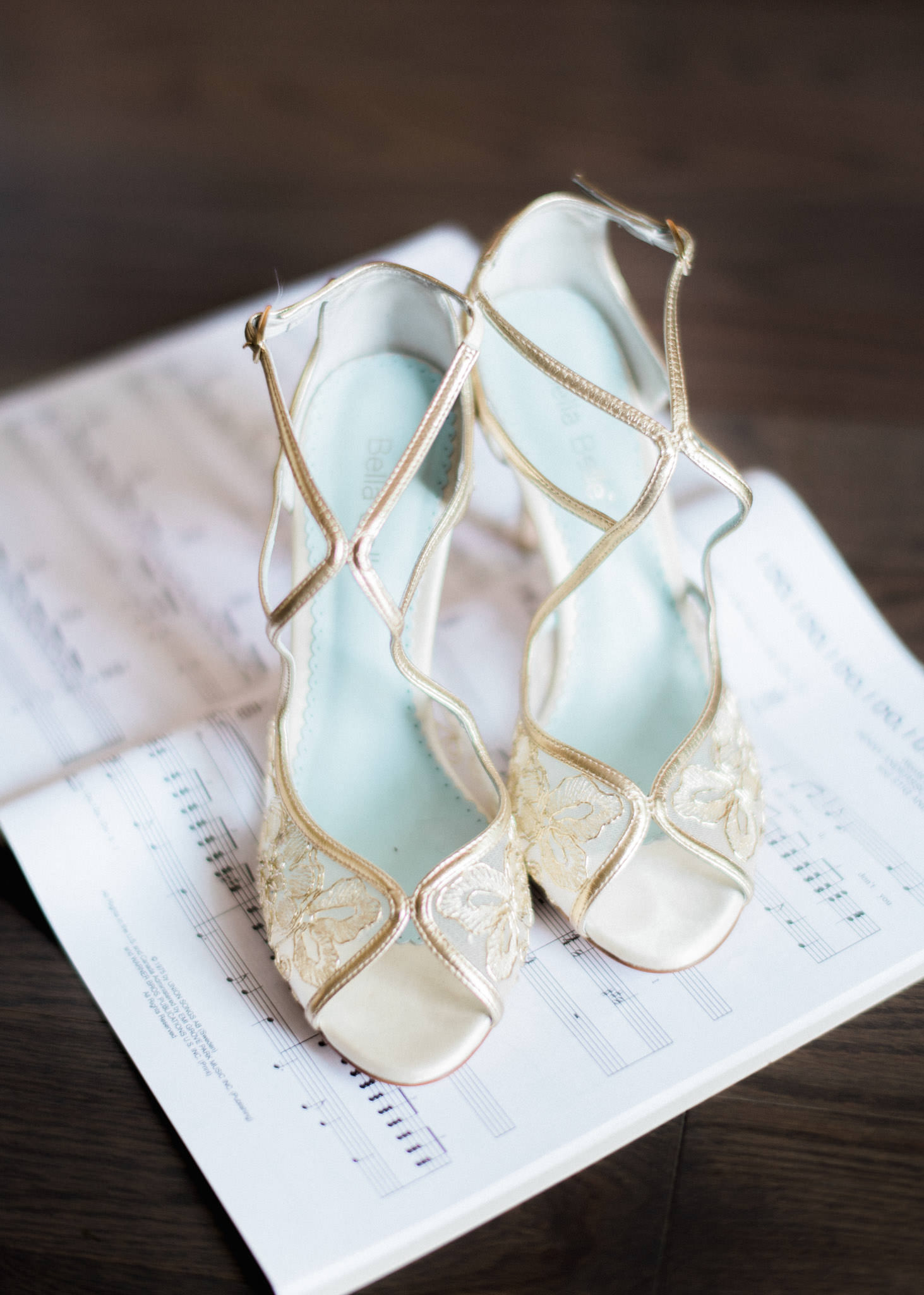 Creative shot of wedding shoes on a music sheet