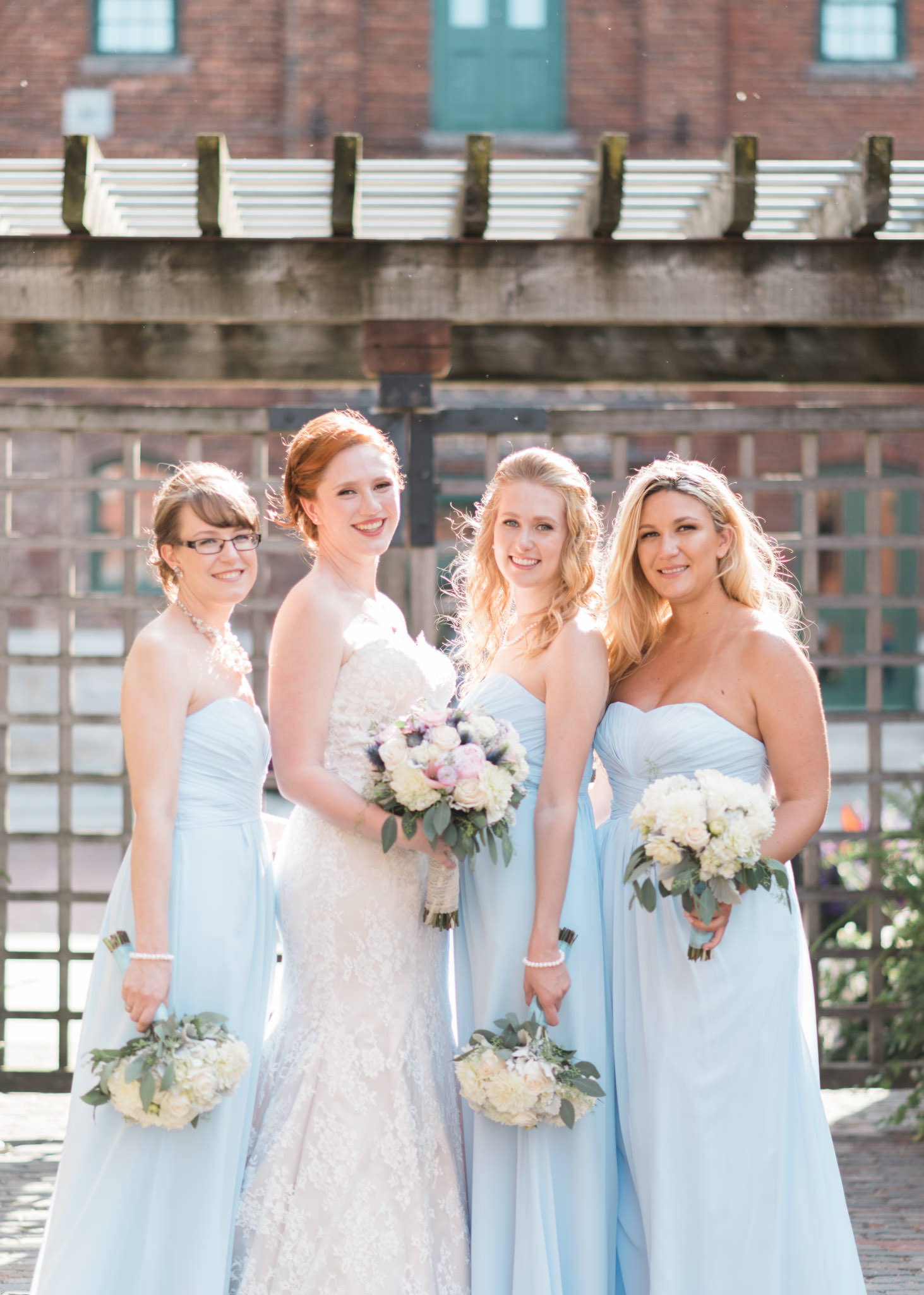 Bride and bridesmaids pose at Archeo in Distillery District wedding