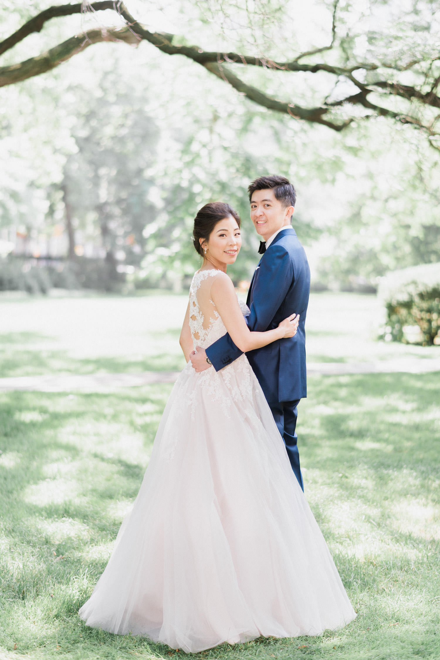 Bride and groom pose at Osgoode Hall in Toronto Wedding