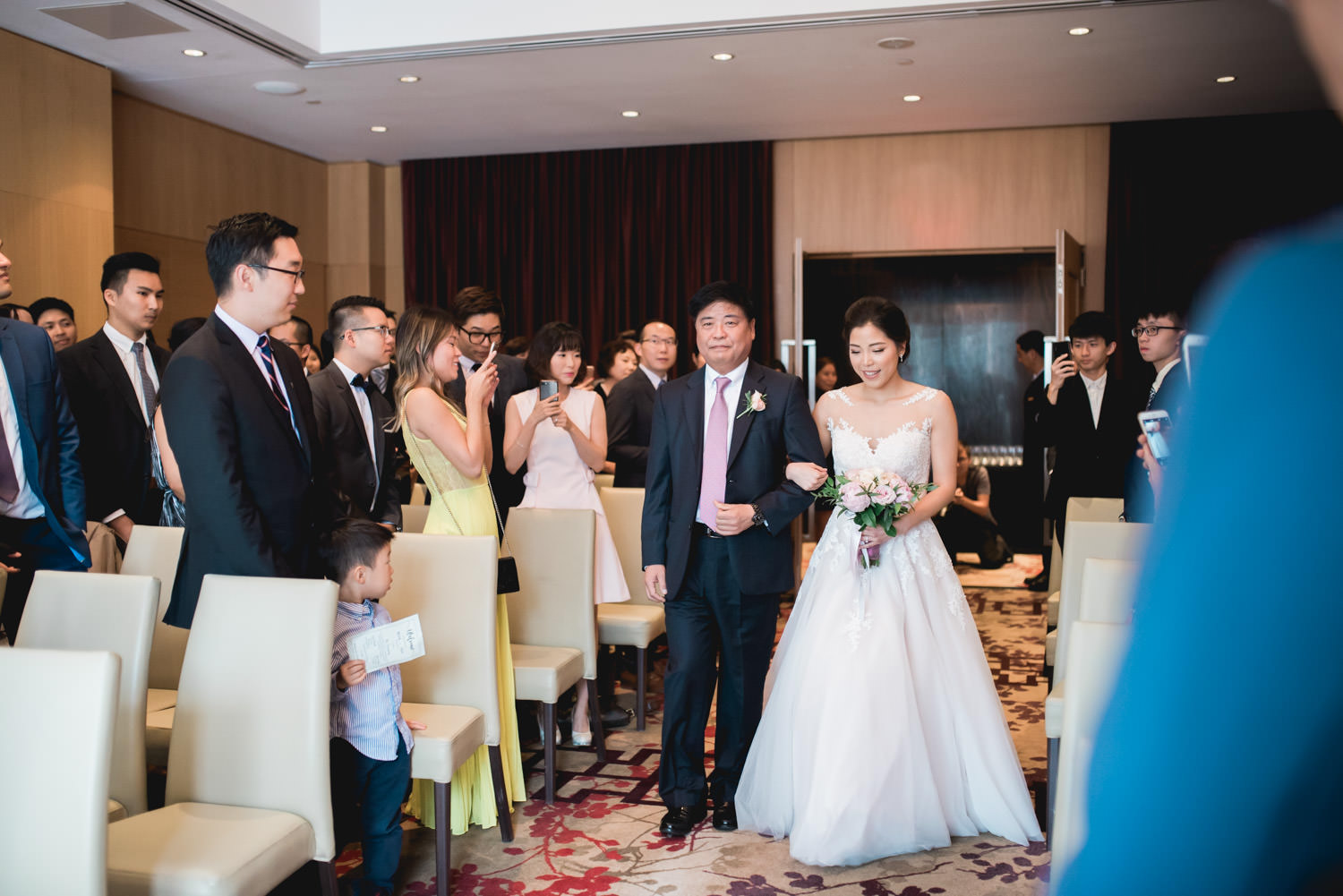 Father walks bride down the aisle for the ceremony at Shangri-La Hotel in Toronto