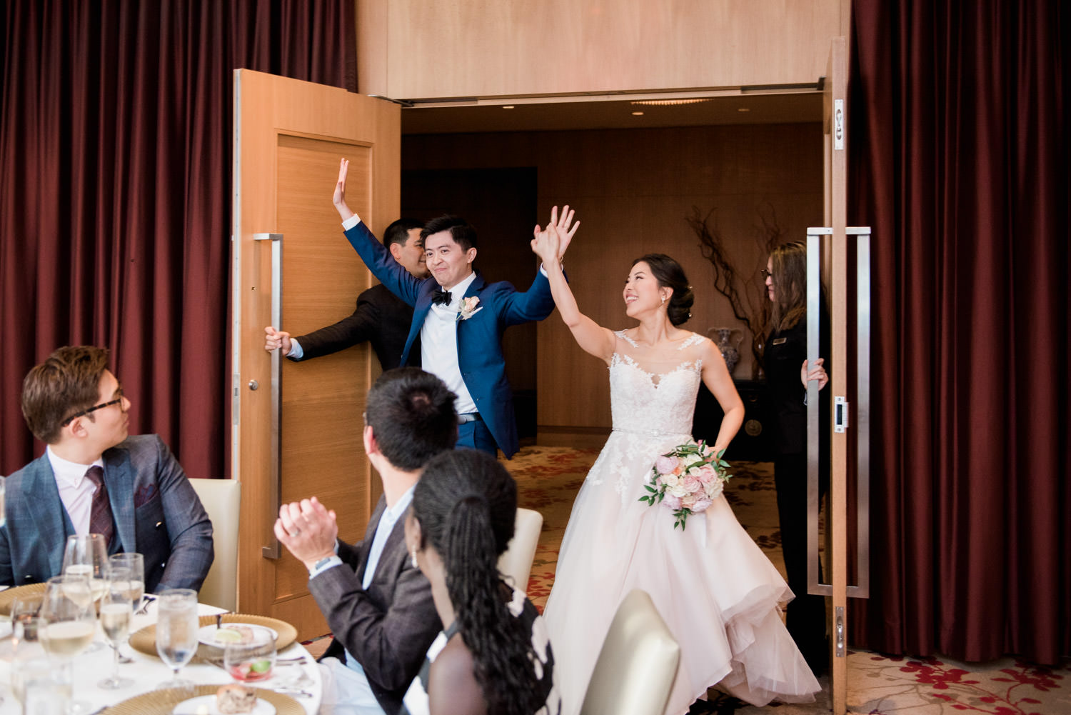 Bride and groom enter reception at Elegant wedding reception at the Shangri-La Hotel in Toronto