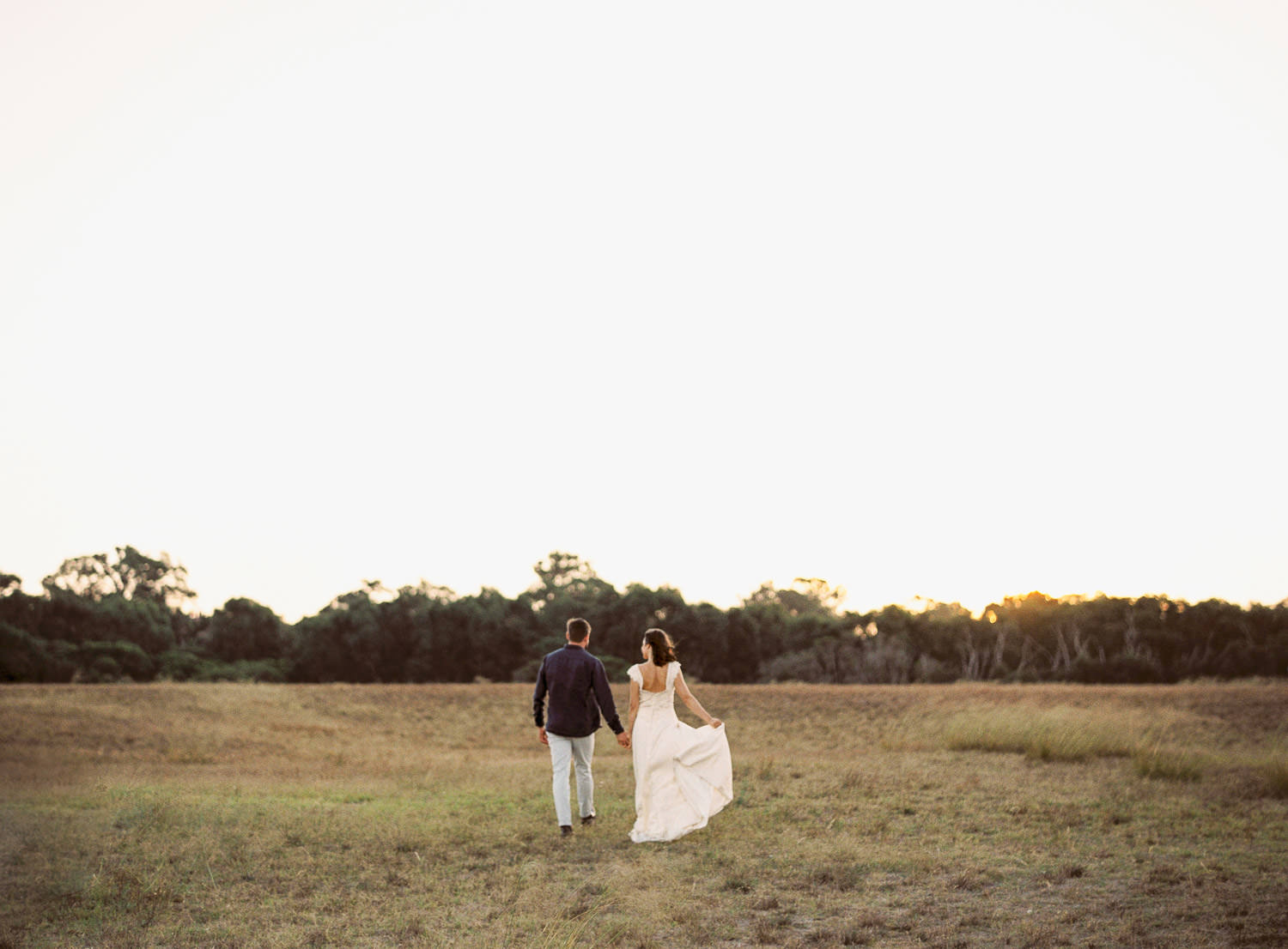 Couple walking into the sunset during wedding at Perry's Paddock Perth