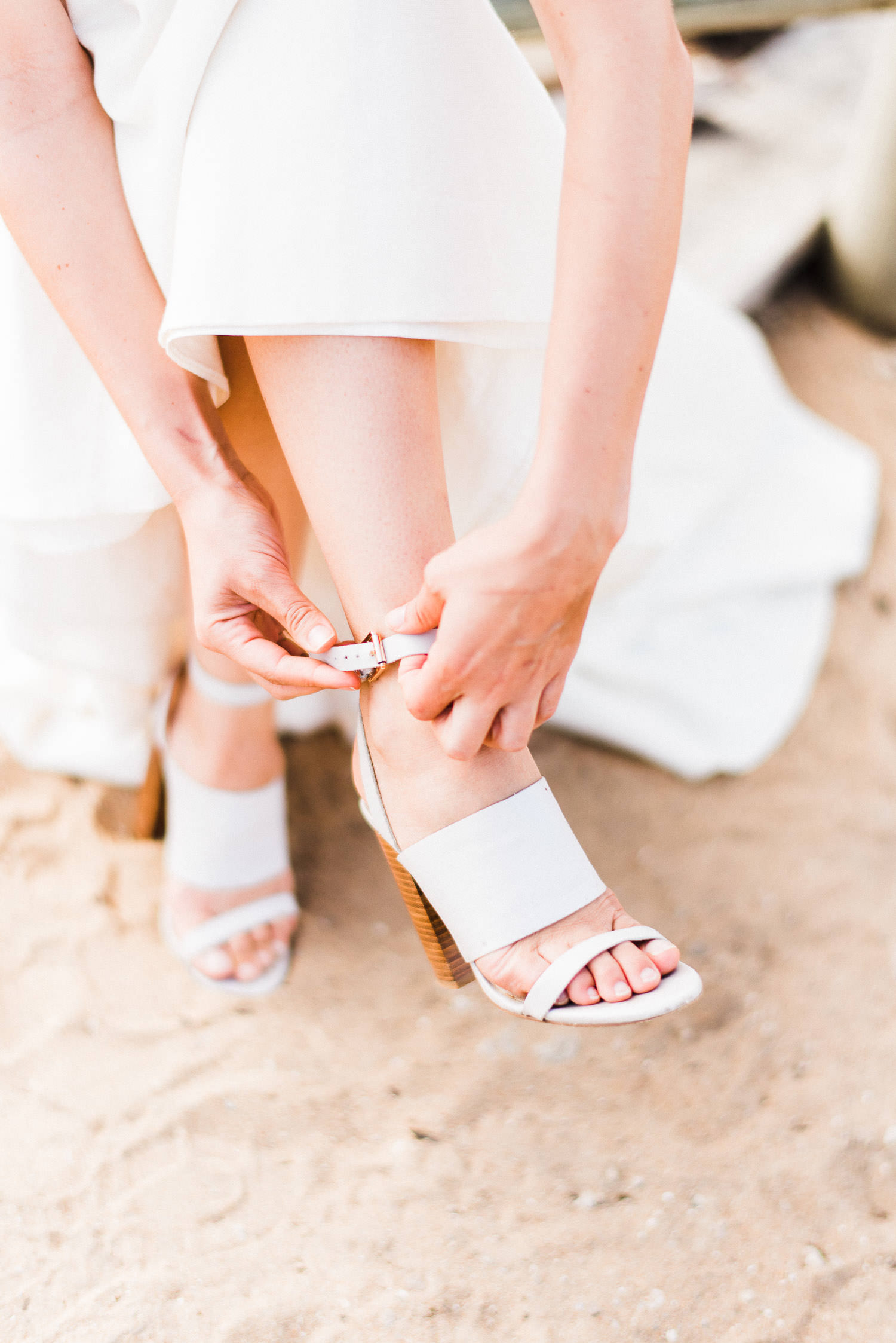 bride putting on her shoes at elopement in Perth Australia