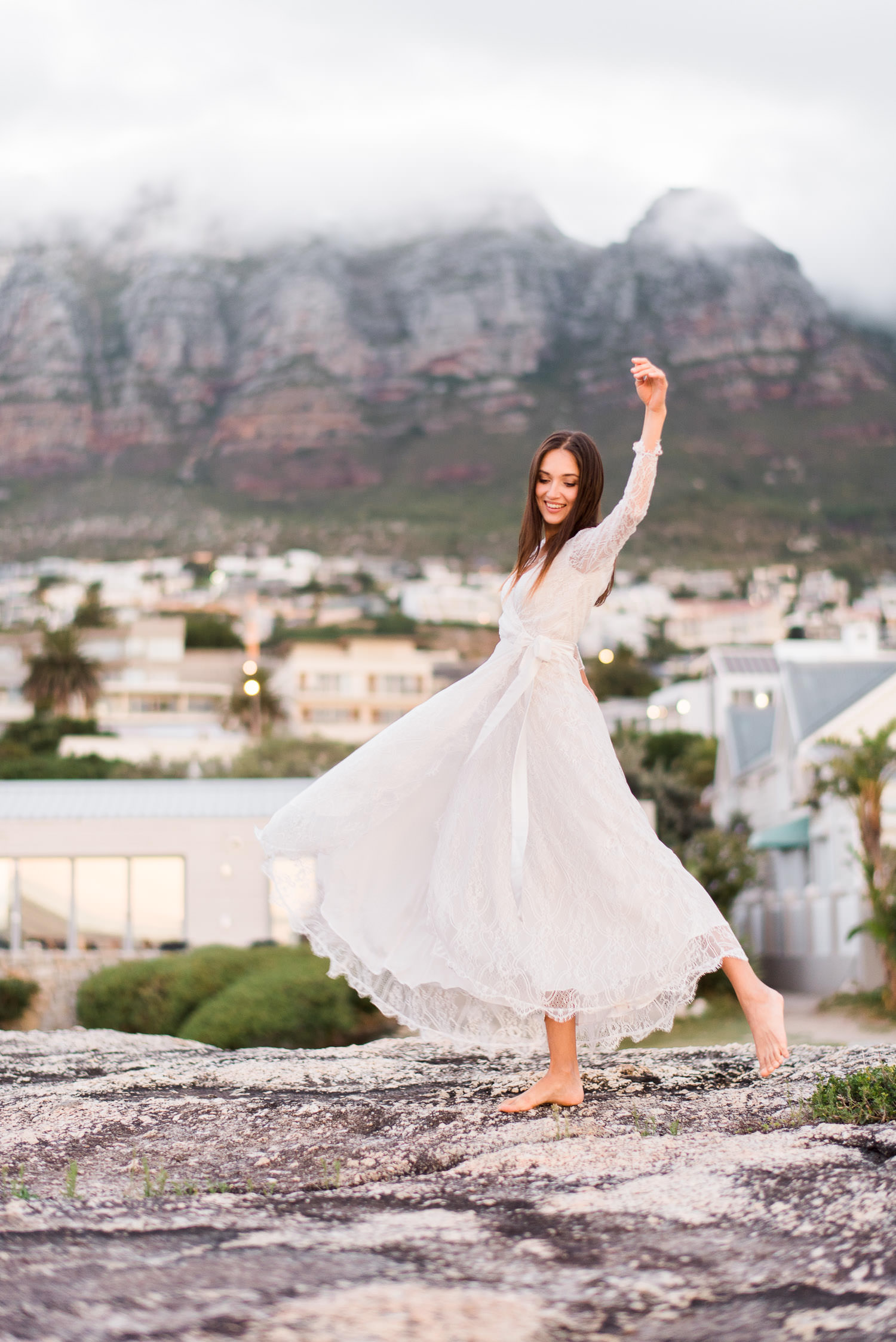Julie dances in a Catalfo dress at sunset in Camps Bay engagement session in Cape Town