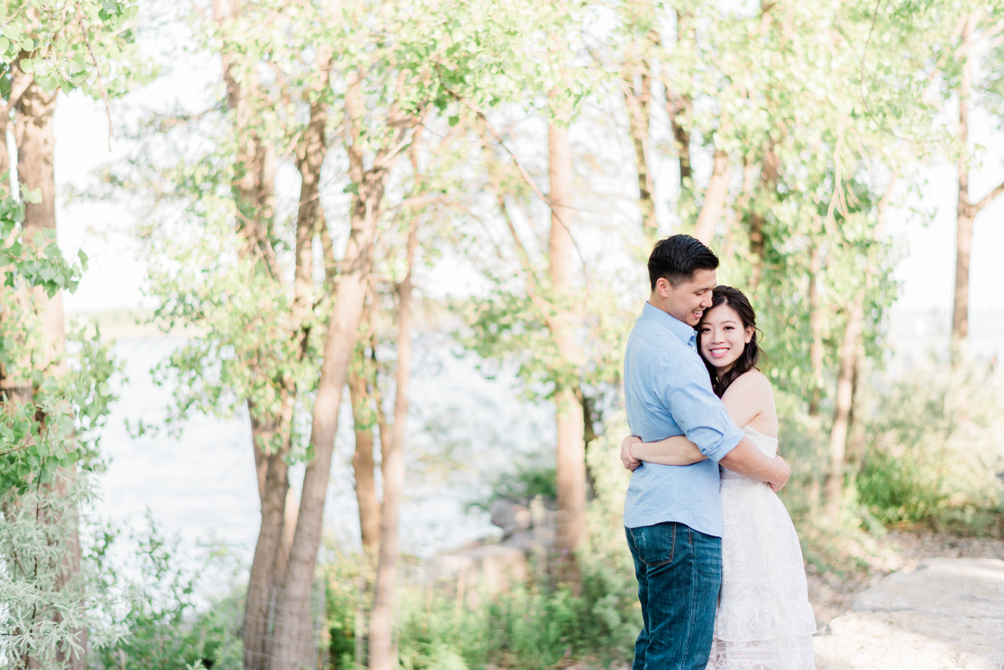 Couple hugging during an engagement session at Trillium Park in Toronto