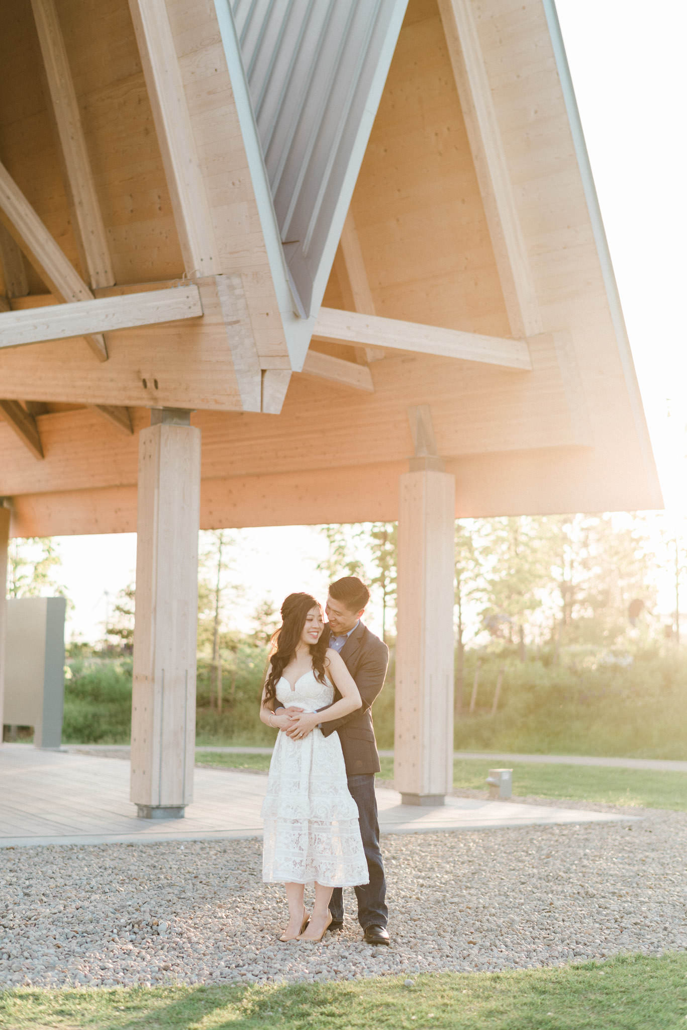 Epic engagement of a couple shot under the pavilion at Trillium Park during sunset