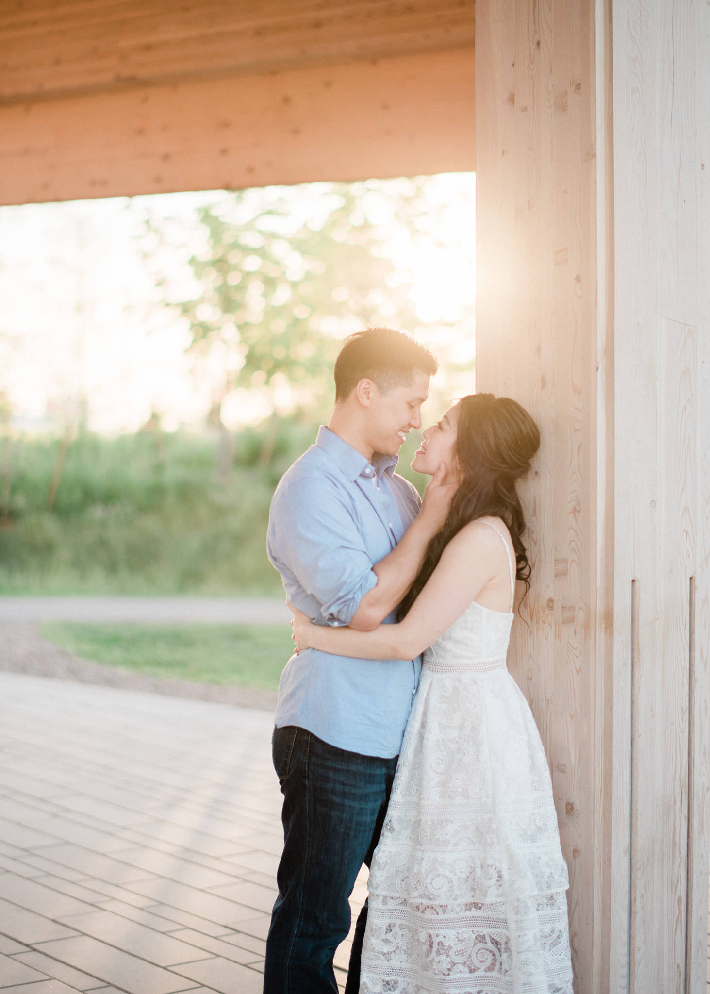 romantic photo of couple under the pavilion at Trillium Park during sunset