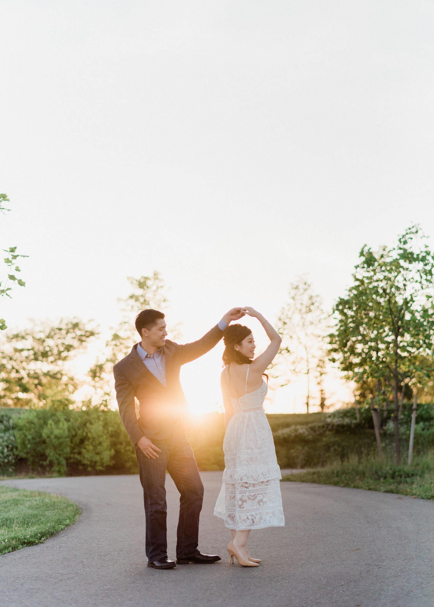 Couple dancing at sunset in Trillium Park during engagement session