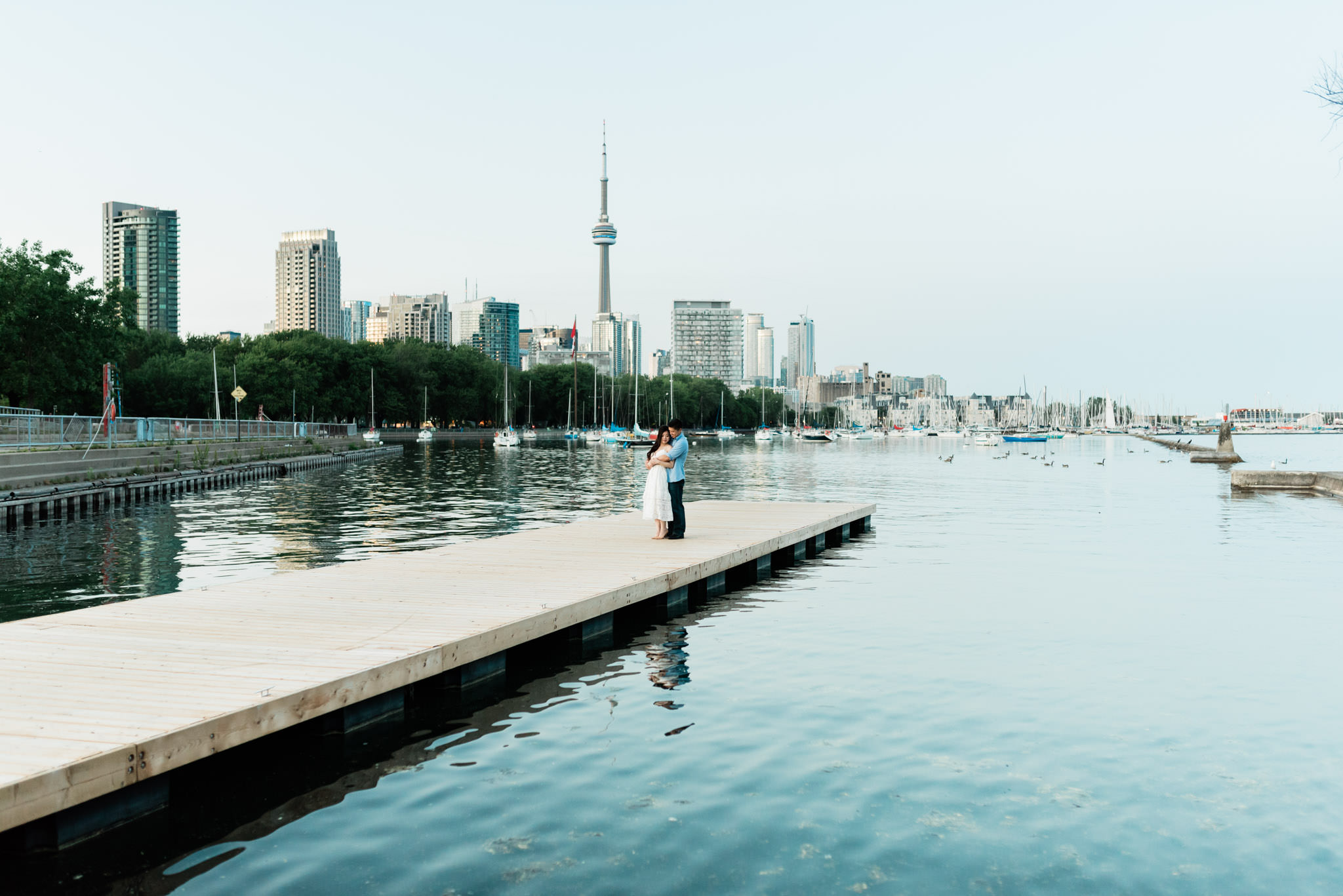 Engagement shoot at a dock in Trillium Park in Ontario Place