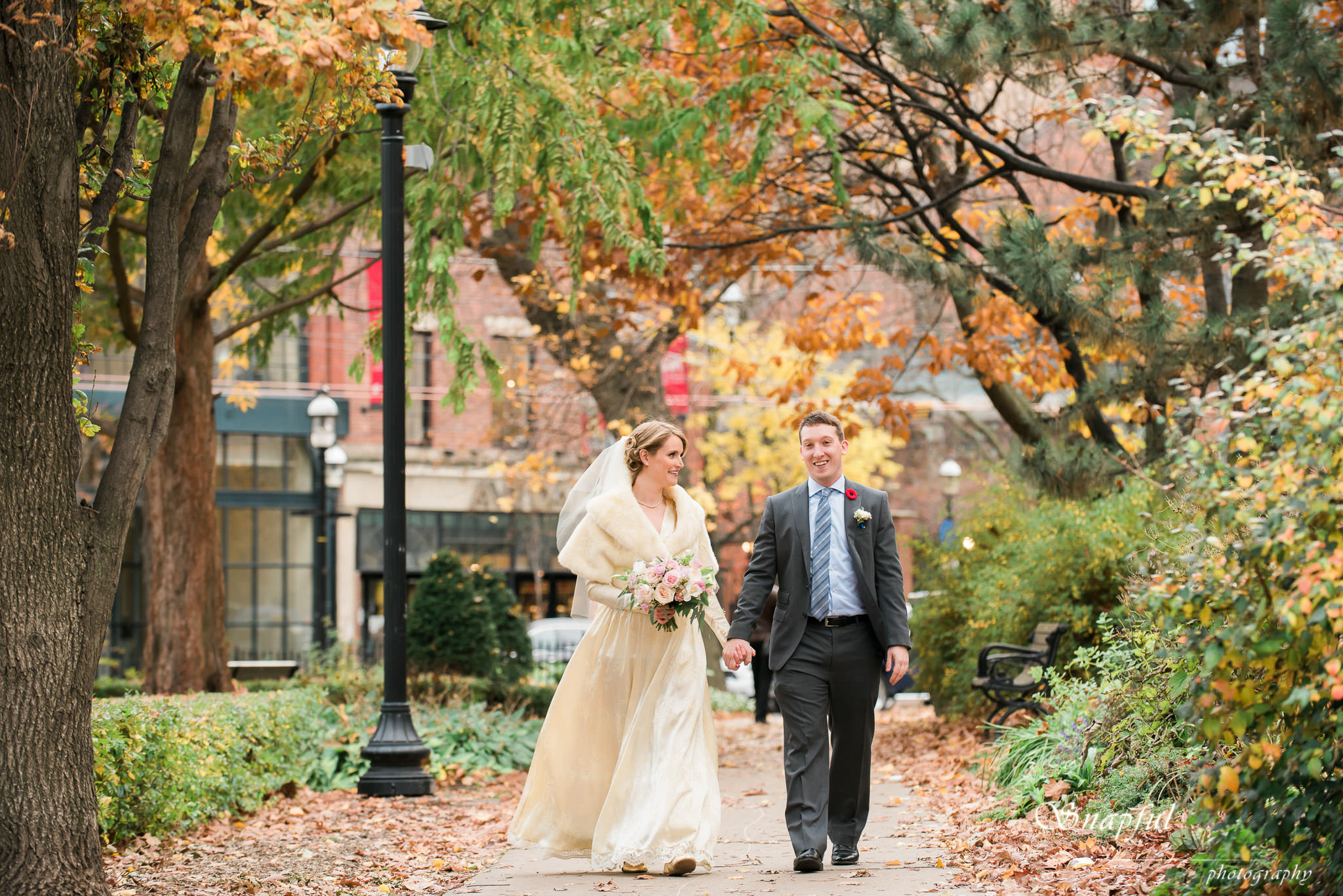 Bride and groom walk through St-James Park in Toronto