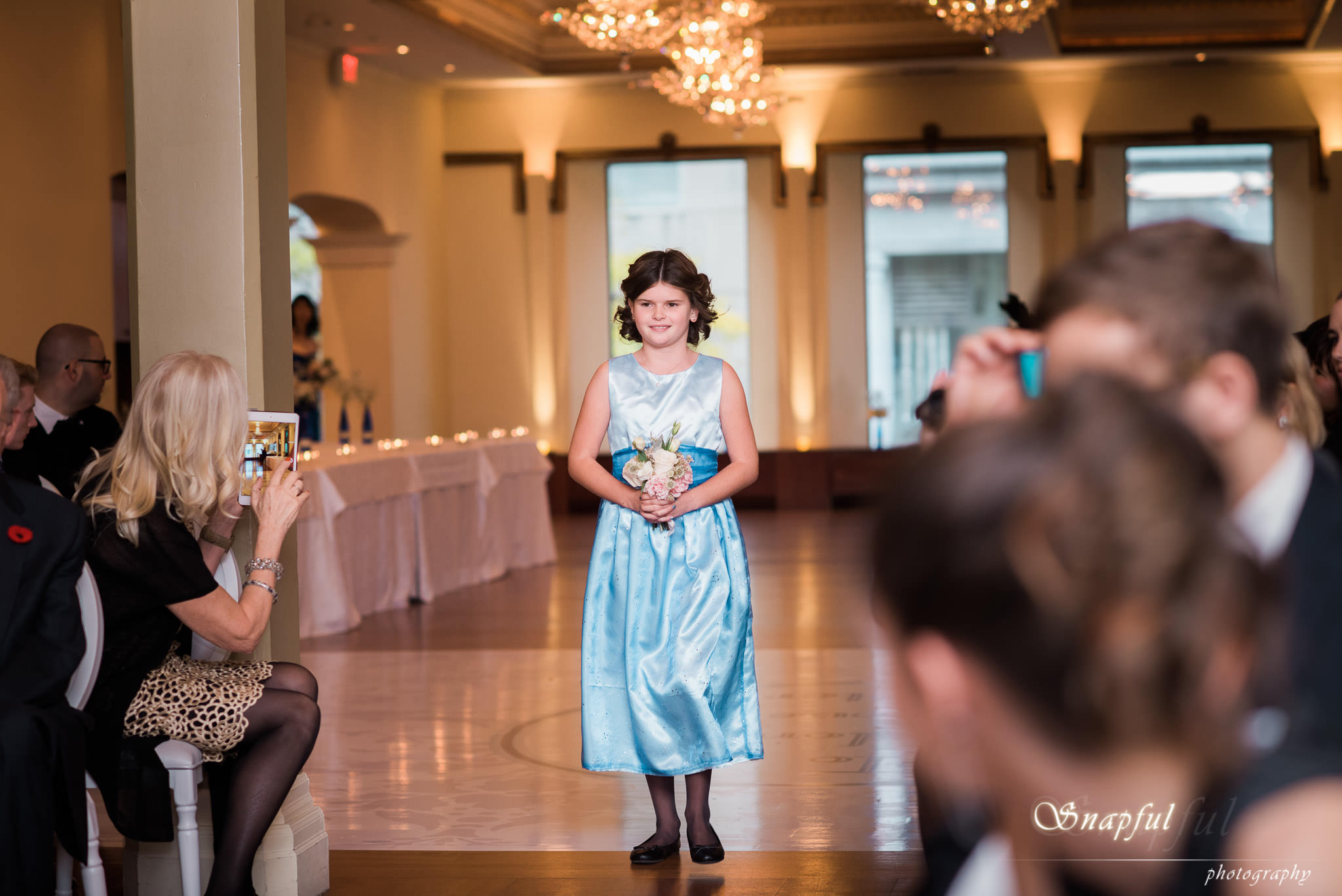 bridesmaid walking down the aisle at the Rosewater in Toronto