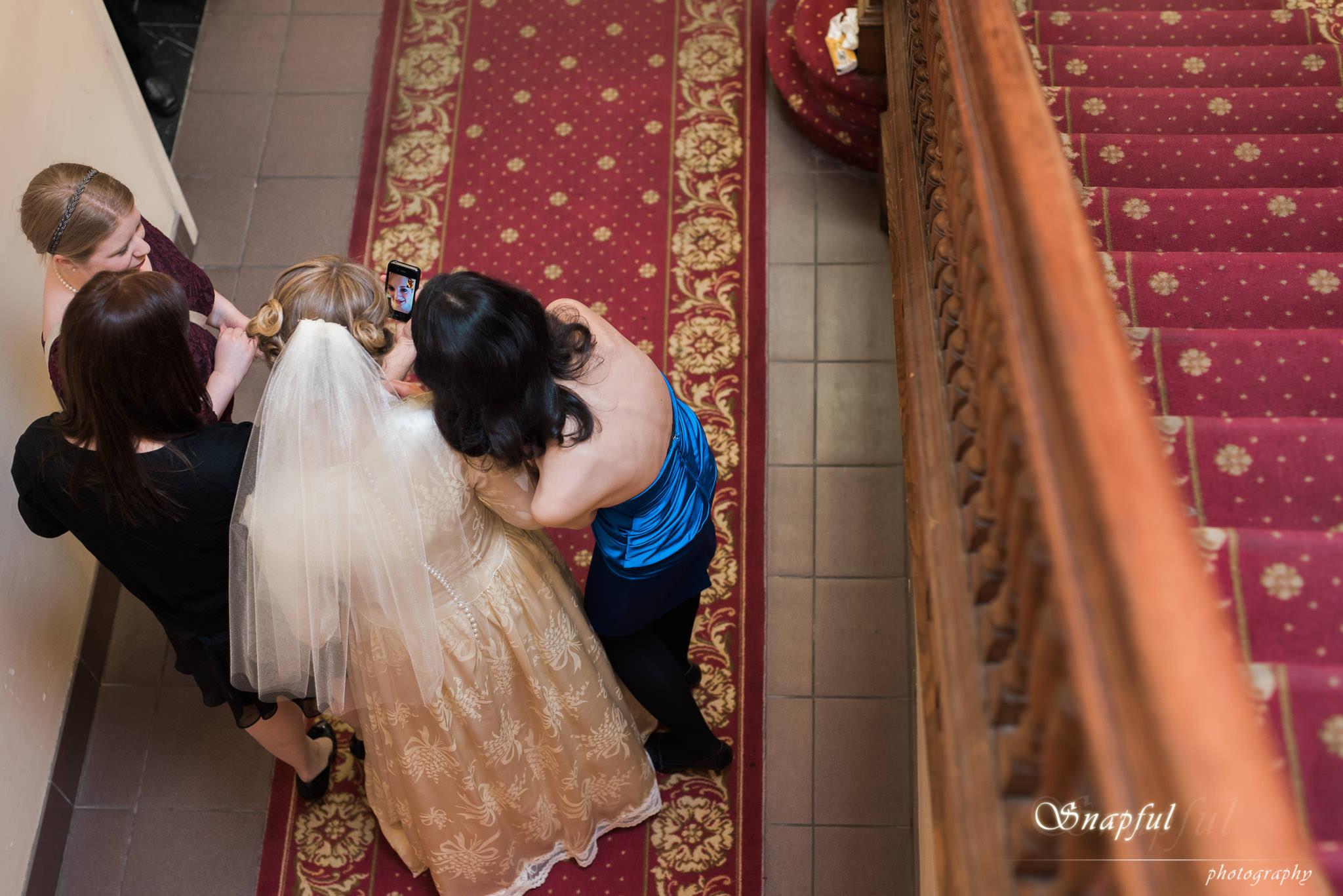 Bride sharing a moment with her bridesmaids
