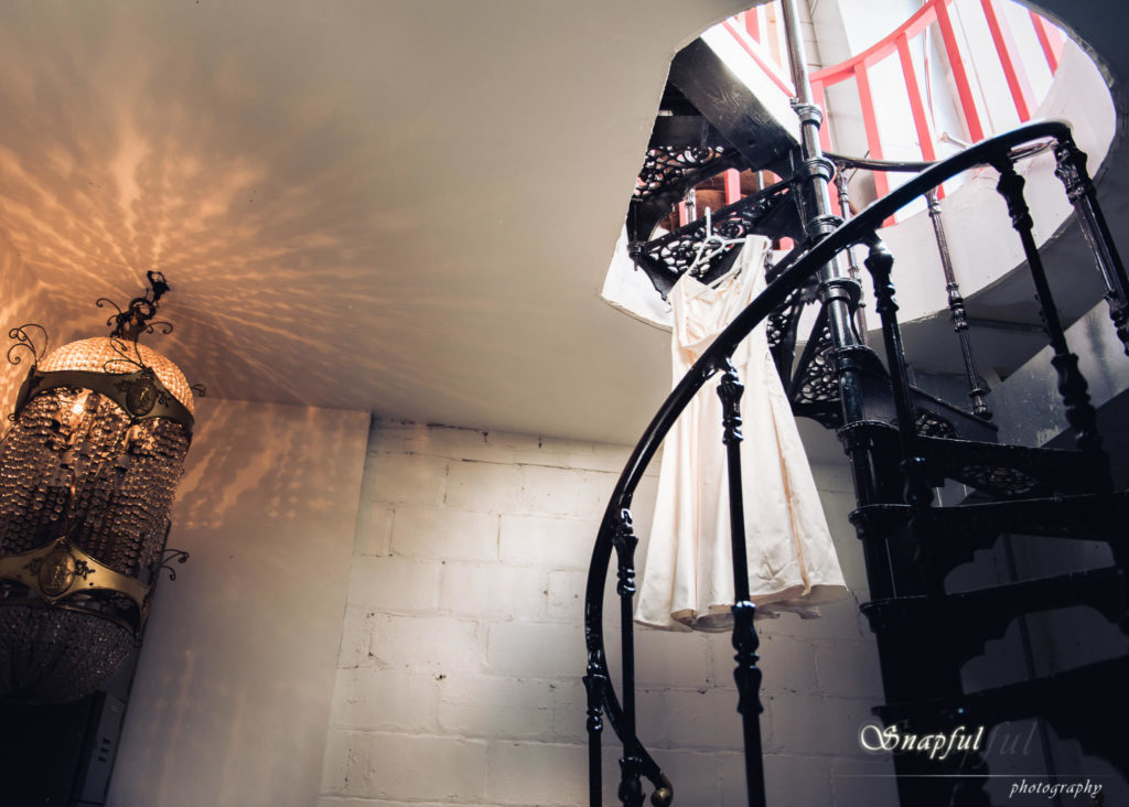 wedding dress hung on a staircase