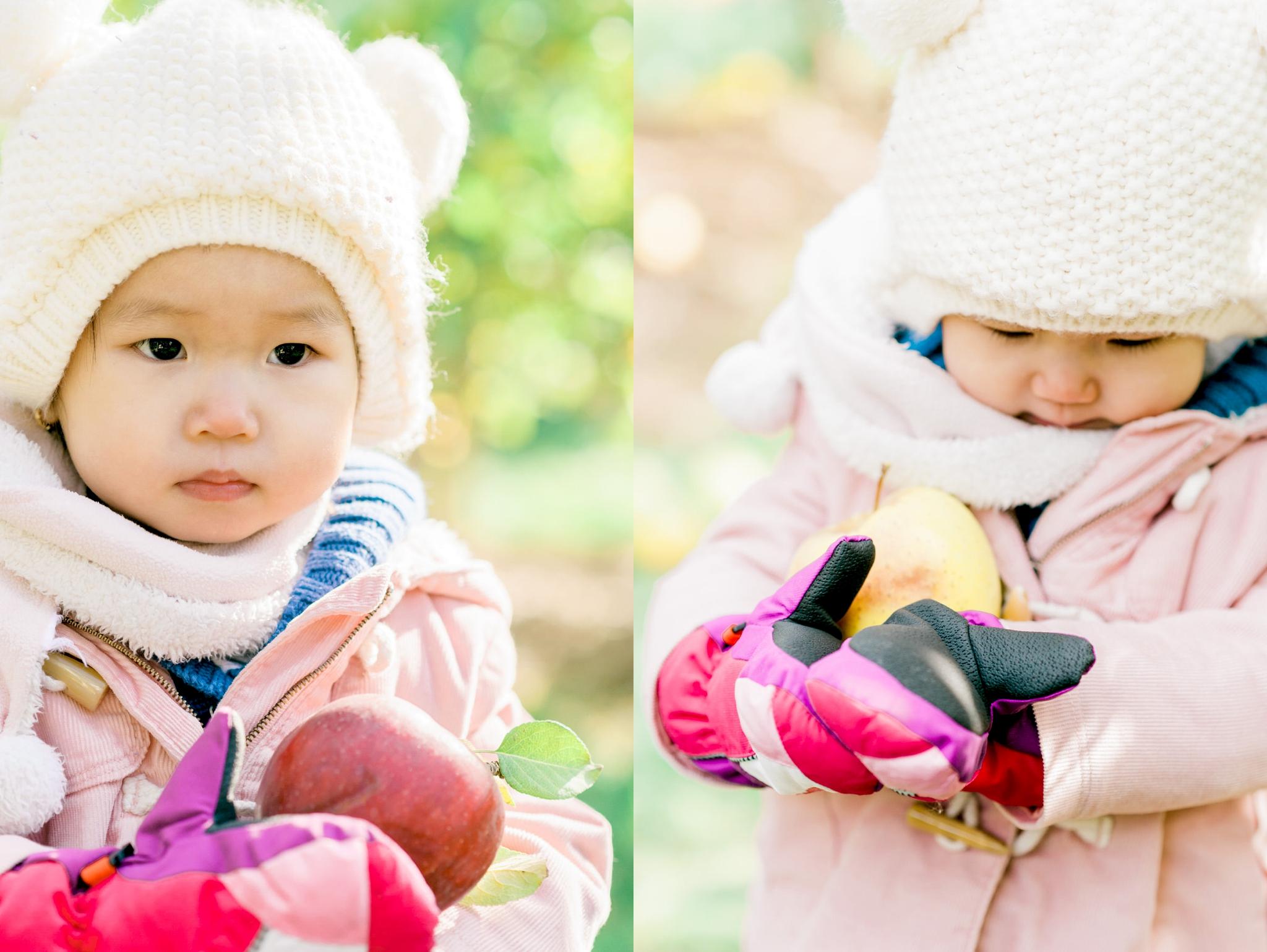 Child holding her apple