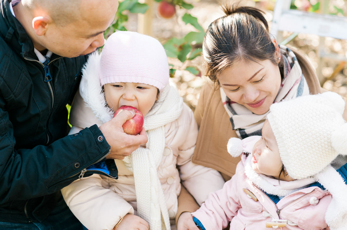 family eating apples together