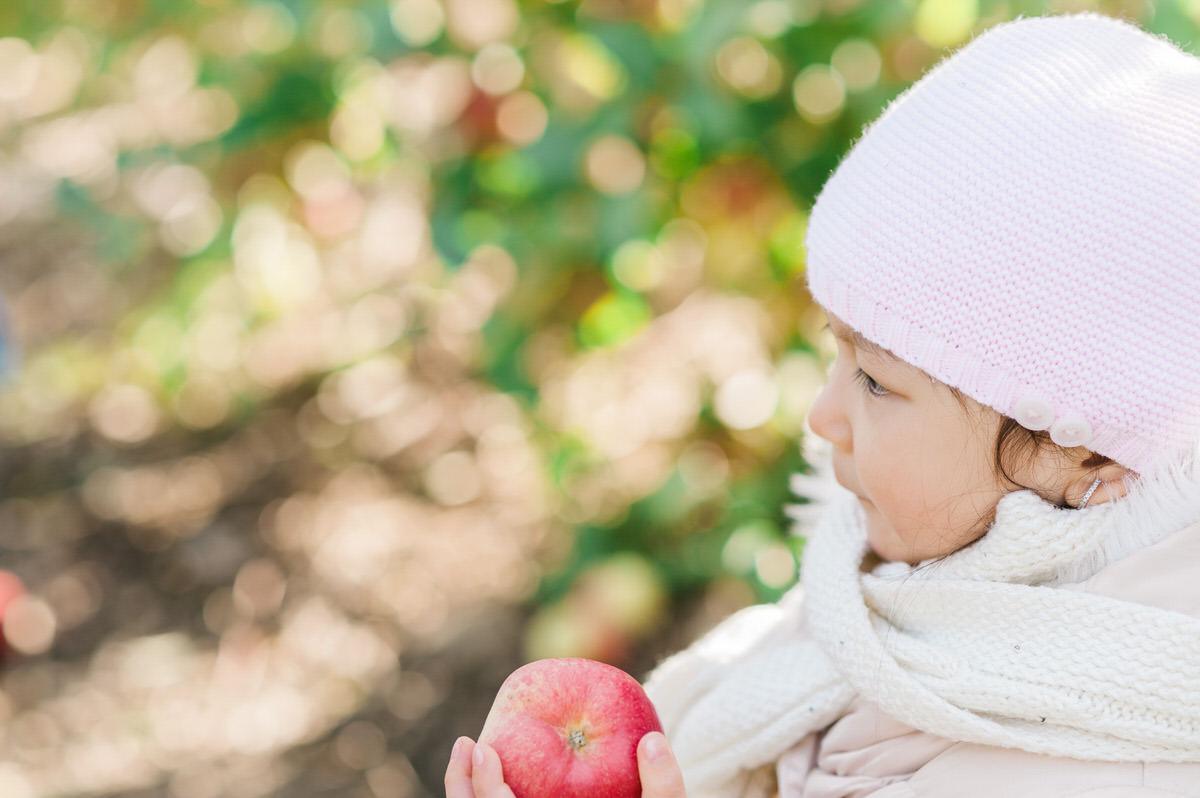 girl holding her apple
