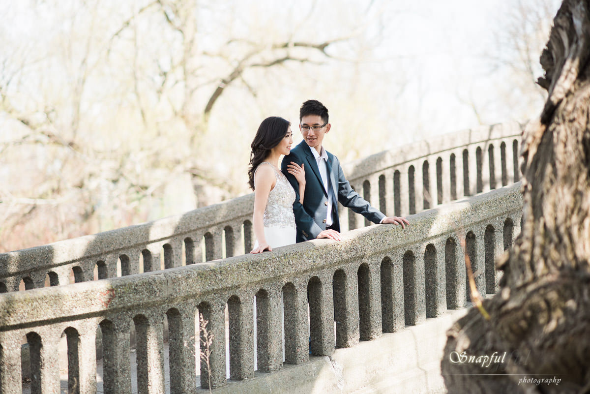 beautiful couple standing on a bridge on Centre Island