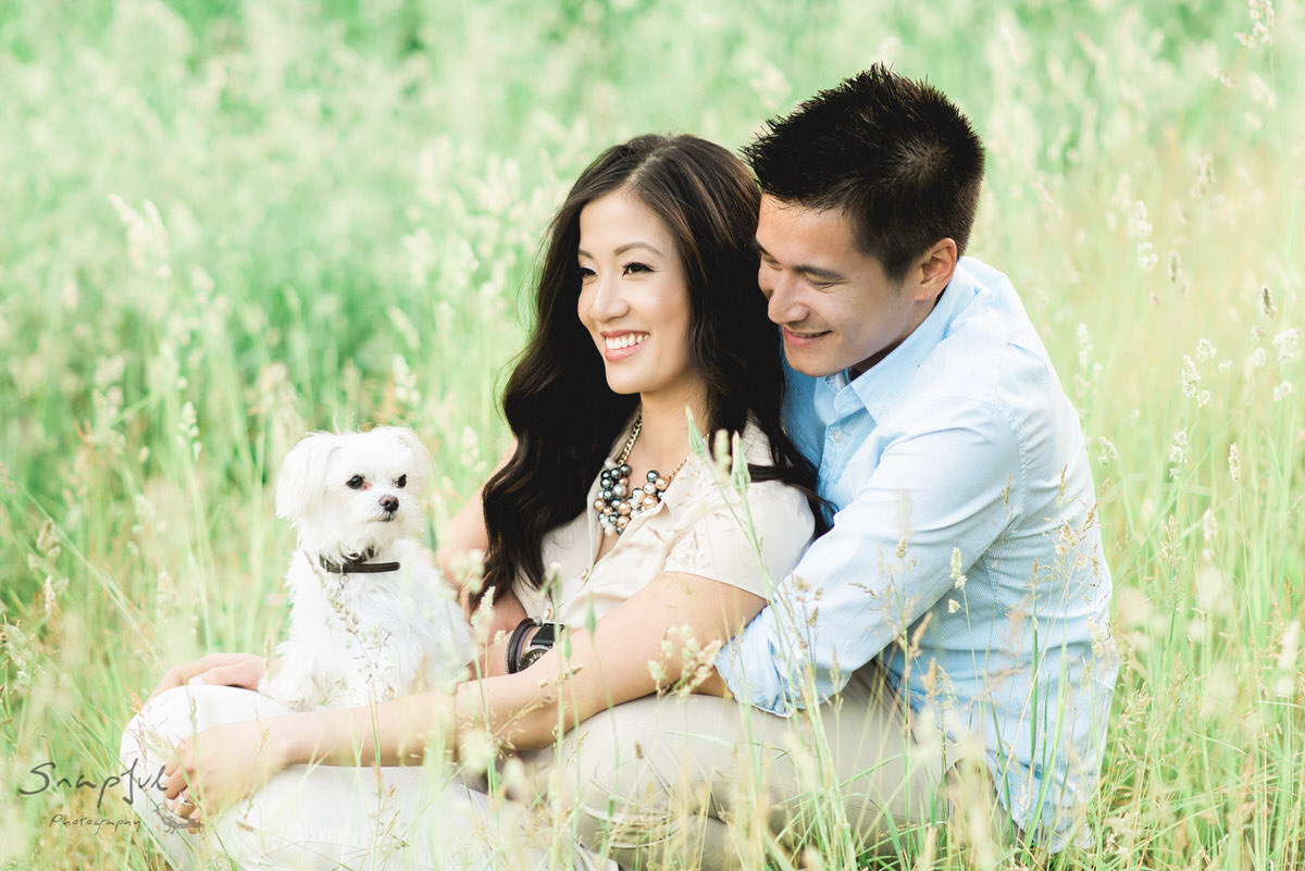 Couple sharing a laugh with their dog