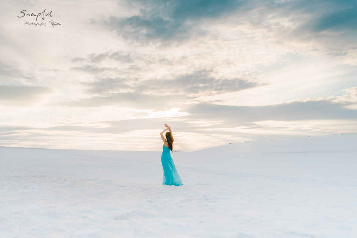 Woman in blue dress in the snow Iceland