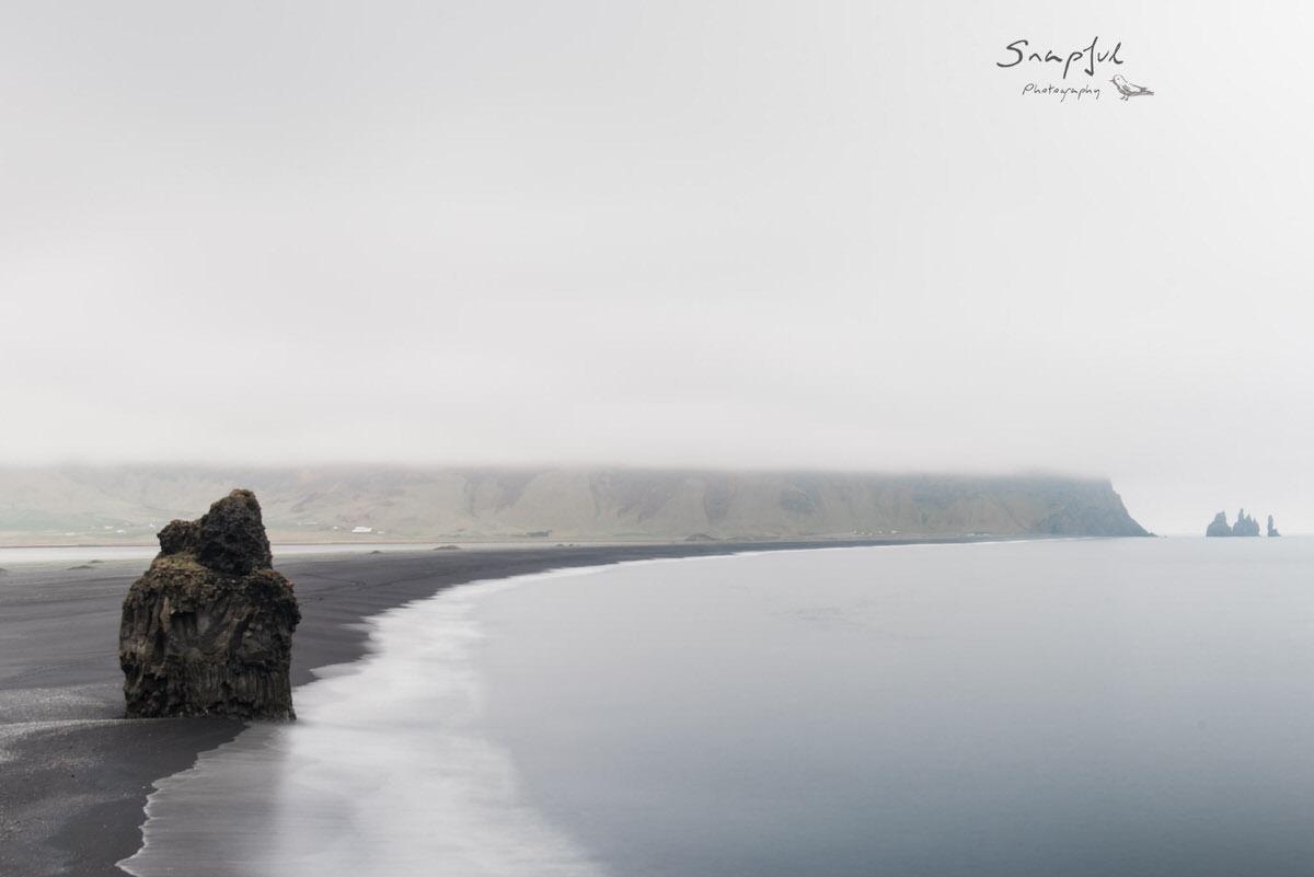 Black sand beach on overcast day